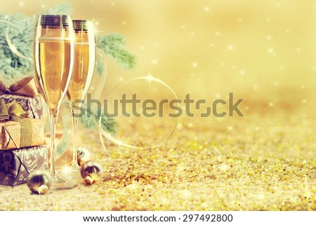 Two champagne glasses ready to bring in the New Year. - stock photo
