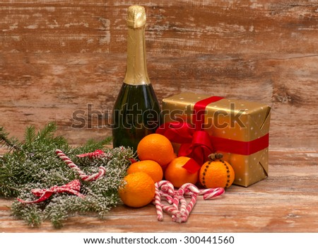 Two champagne glasses ready to bring in the New Year over wooden background - stock photo