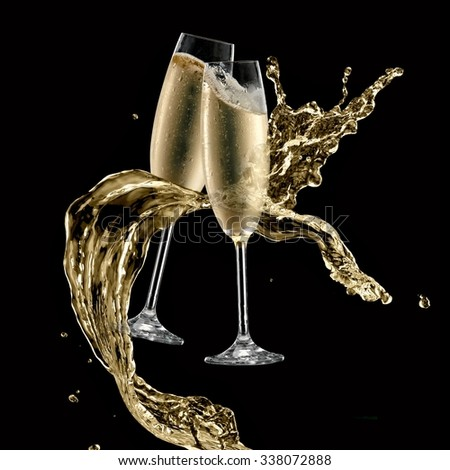 Two champagne glasses splash on black background - stock photo