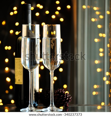 two champagner glasses on glass table with black bokeh background