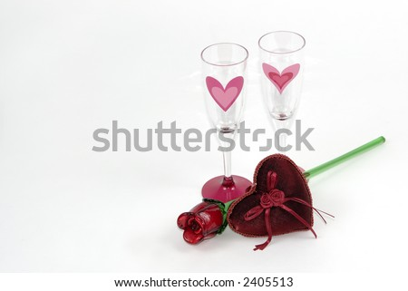 Two champaign glasses,a red rose and a red heart on white with room for text. - stock photo