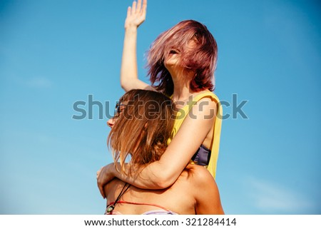Two Cheerful Females Having Fun Outdoors - stock photo