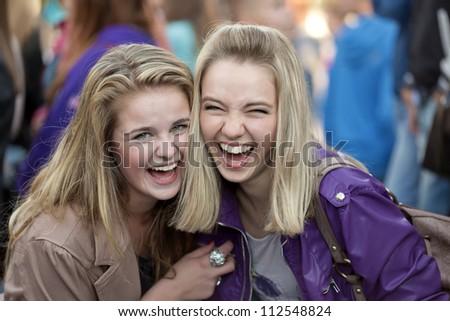 Two cheerful girls - stock photo
