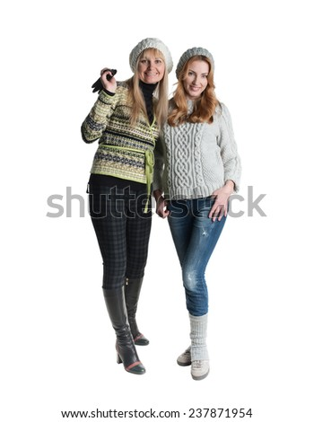Two cheerful girls twins, in the street, two friends in the studio - stock photo