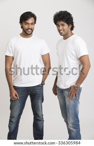 Two cheerful Indian young man posing. - stock photo