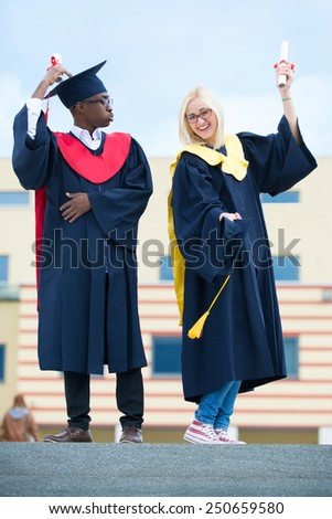 two cheerful student of a graduate - stock photo