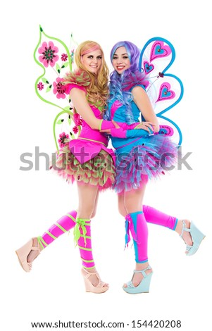 Two cheerful women wearing colorful butterfly costumes. Isolated on white  - stock photo