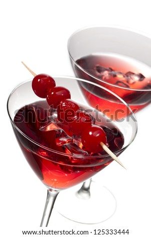 Two cherries cocktail drinks in a macro and crop image - stock photo