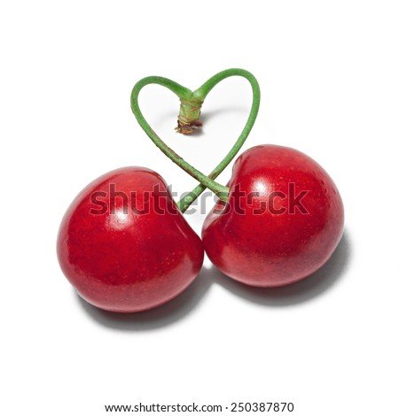 two cherries tied into a heart love - stock photo