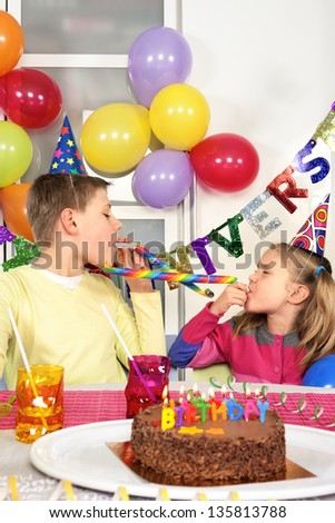 Two children at funny birthday party - stock photo
