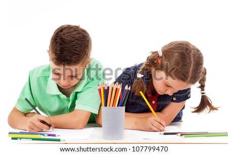 Two children drawing with colorful crayons, isolated over white - stock photo