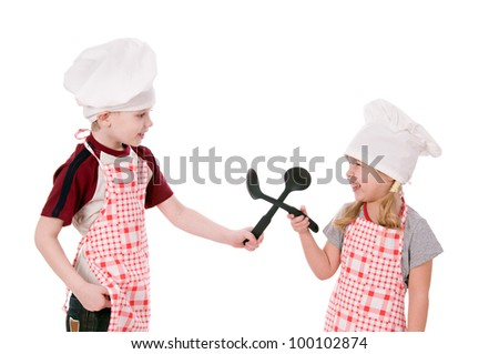 Two children dressed in chef isolated on the white background - stock photo