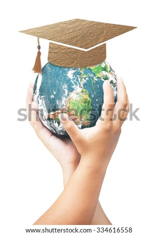 Two children hand holding planet with graduation cap made of brown fabric texture isolated white background. E-learning Education, Back To School concept. Elements of this image furnished by NASA. - stock photo