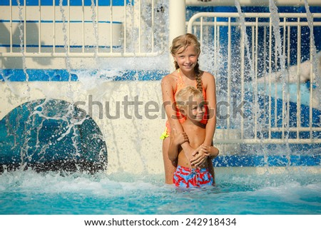 Two children having fun at the swimming pool