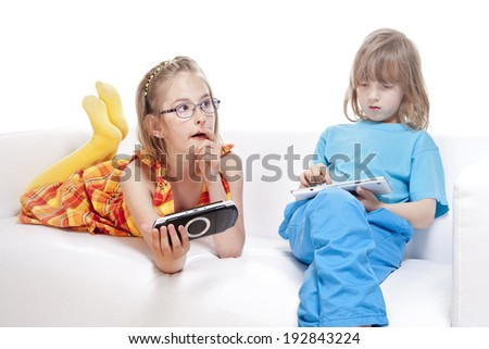 Two Children Having Fun with Digital Gadgets - Isolated on White - stock photo