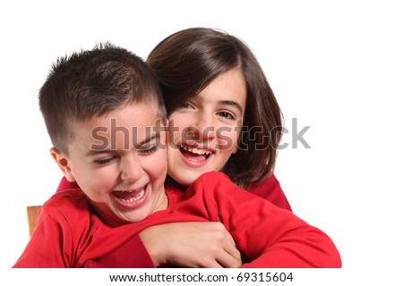 Two Children hugging isolated on white