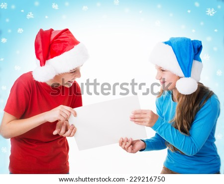 two children in santa hats are holding blank board , isolated over white - stock photo