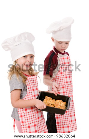 two children in the chef's hat isolated on white background - stock photo