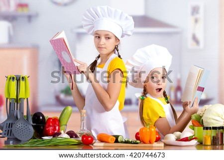 Two children in the kitchen with the food starts to cook