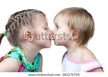 Two children look at each other and touched noses isolated on white background - stock photo