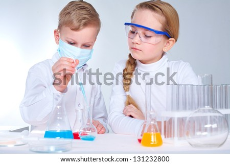 Two children making chemical experiments - stock photo