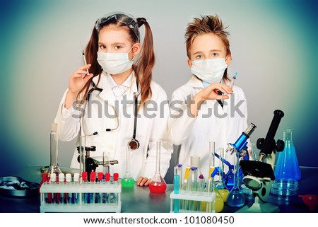 Two children making science experiments. Education. - stock photo