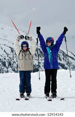 two children on skis - stock photo