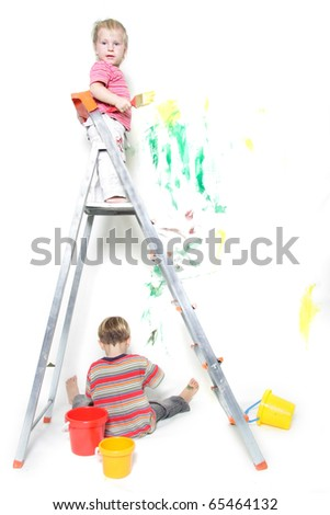 two children painting over white - stock photo