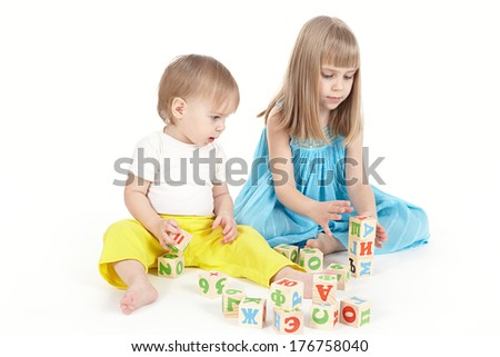 Two children play with cubes - stock photo