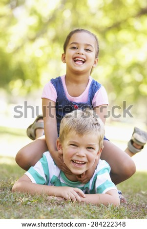 Two Children Playing Together In Park - stock photo