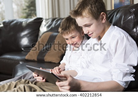 Two Children playing with tablet pc