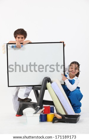 Two children pretending to be decorating