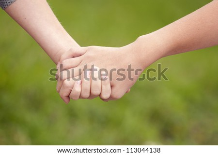 two children's hands keeping together - stock photo