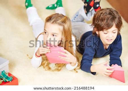Two children sending wishlist letter to Santa Claus for christmas - stock photo