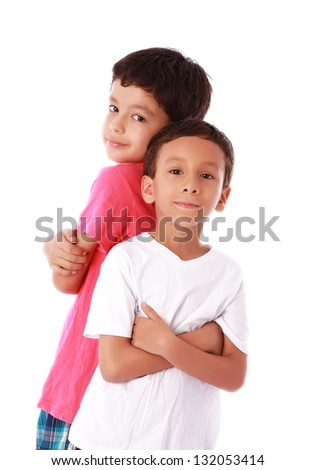 Two children standing back to back over white background