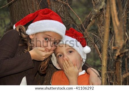 two children think they hear santa - stock photo