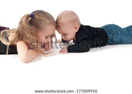 Two children touching to each other's foreheads - stock photo