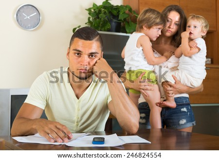 Two children watching parents abusing one another at home  - stock photo