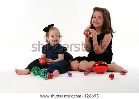 Two children with Christmas ornaments