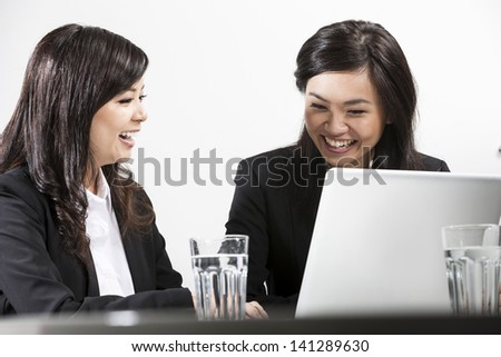 Two Chinese business women people having a meeting together