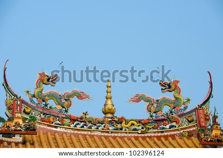 Two chinese dragon on the roof of temple.