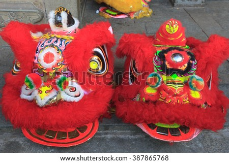 Two Chinese lion dance heads - stock photo