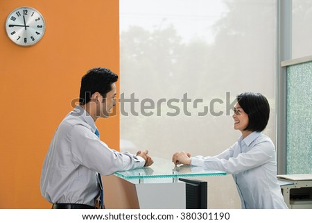 Two Chinese office colleagues - stock photo