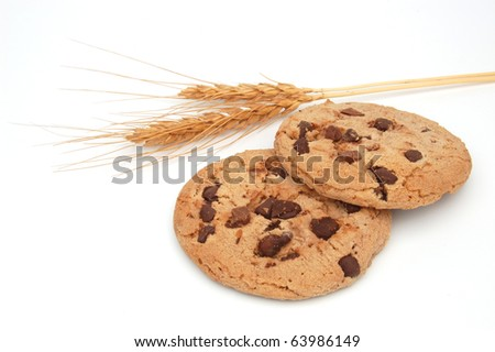 Two chocolate chip cookies with wheat ears on white background
