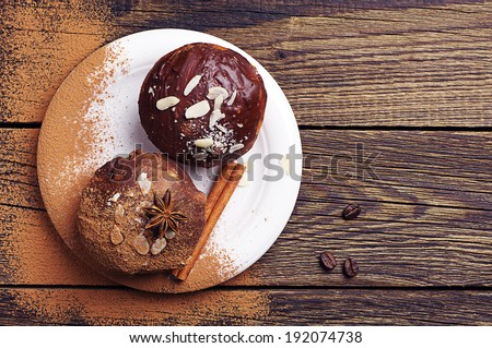Two chocolate cupcake with nuts on vintage wooden table. Top view - stock photo