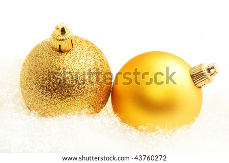 Two christmas ball on the snow and white background