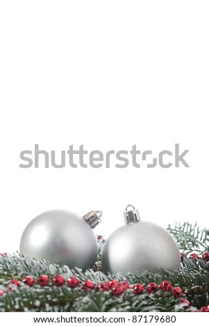two christmas balls branch fir over white background