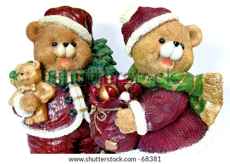 Two christmas bears on a white background.