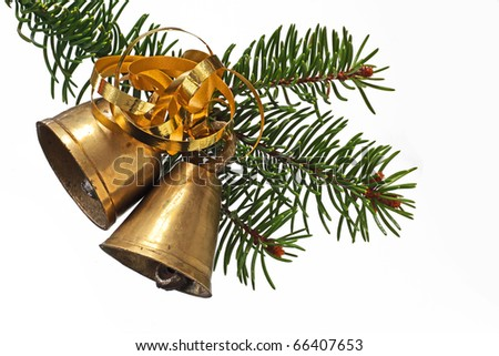 two christmas bells hanging at fir branch - stock photo