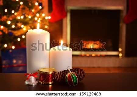 two christmas candles focus on flame shallow DOF - stock photo